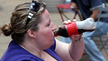 Coke-woman-drinking-bottle-jpg
